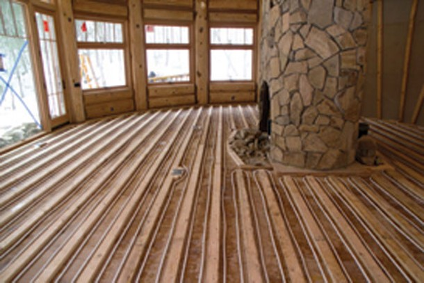 The Moonhaw Residence, a log home in Ulster County, has 8,000-square feet of radiant heating embedded in concrete in the basement and in Gypcrete in the upper floors installed by Advanced Radiant Design. The photos illustrate the installation process.