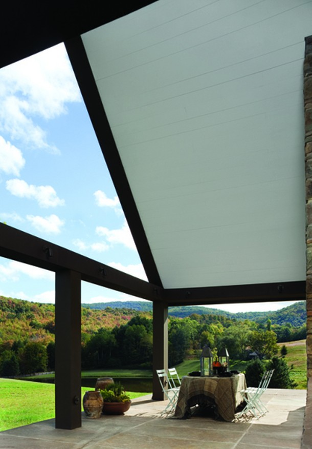 The north end of the house was extended with a covered stone terrace for outdoor dining and views of the Catskill Mountain landscape. - PAUL WARCHOL