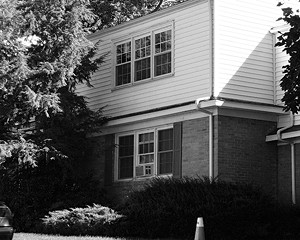 The photos accompanying this article are of houses where domestic violence occurred. Robin Conroy was murdered in New Paltz in 2005.