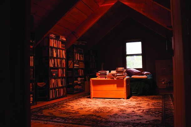 The third floor loft bedroom, high in the trees, is Wyatt's favorite quiet retreat. - ROY GUMPEL