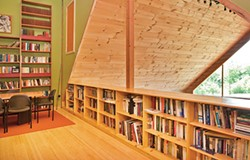 The upstairs office overlooks the living room - DEBORAH DEGRAFFENREID