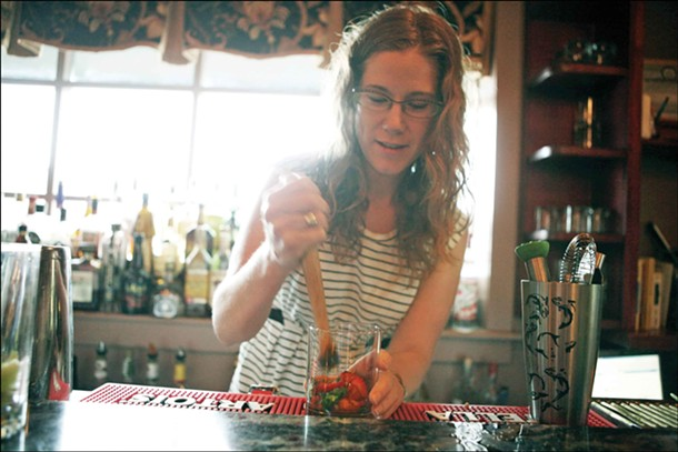 Theresa Fall of 36 Main muddling strawberries for her strawberry mint margarita. - AMBER C. MCPHAIL