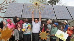 GLORIA WASLYN - This photo of renewable energy enthusiasts was taken in front of the Forsyth Nature Center's solar array in Kingston.
