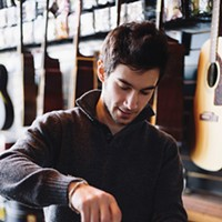 New Paltz Community Tyler Beatrice repairing a guitar at Root Note Music Shop. Thomas Smith