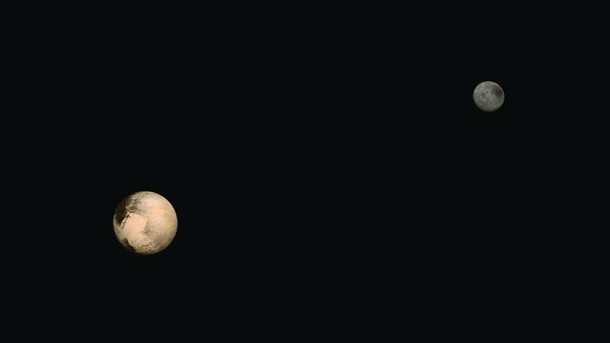 Charon and Pluto in deep space.