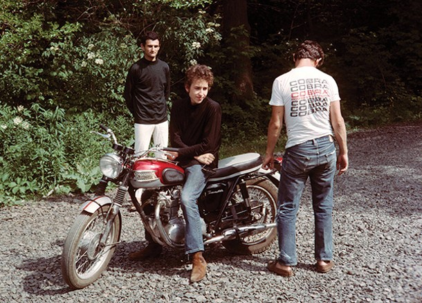Bob Dylan on his Triumph Bonneville with Victor Maymudes (left) and Bobby Neuwirth, Bearsville, summer 1964 - JOHN BYRNE COOKE