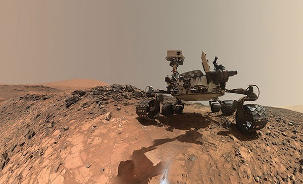 One of many Mars rovers, sent up by curious Earthlings.