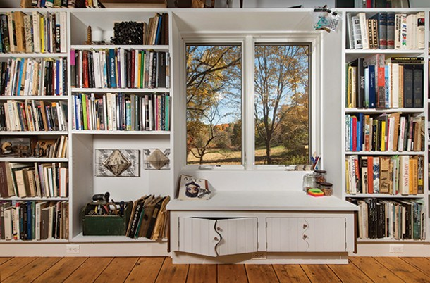A library designed by David Borenstein, converted from an 1820 summer kitchen.