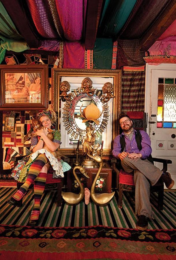 Kat O'Sullivan and Mason Brown, with their dog Lucas, in their living room. - DEBORAH DEGRAFFENREID