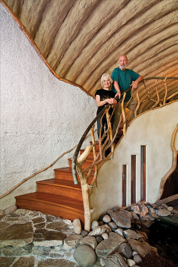 """Linda and Andy Weintraub in the entrance way of their home. In building and maintaining their property they continually ask themselves, """"How much life can we nurture? How much life can we provide for others? How much life can we utilize for ourselves? - DEBORAH DEGRAFFENREID"""