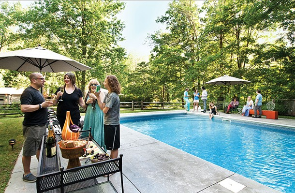 Abbe Aronson (in back) and friends by her saline pool. Both being outside in nature and being surrounded by a community that is so music and art centric are things she's grown to love since moving to Woodstock. - DEBORAH DEGRAFFENRIED