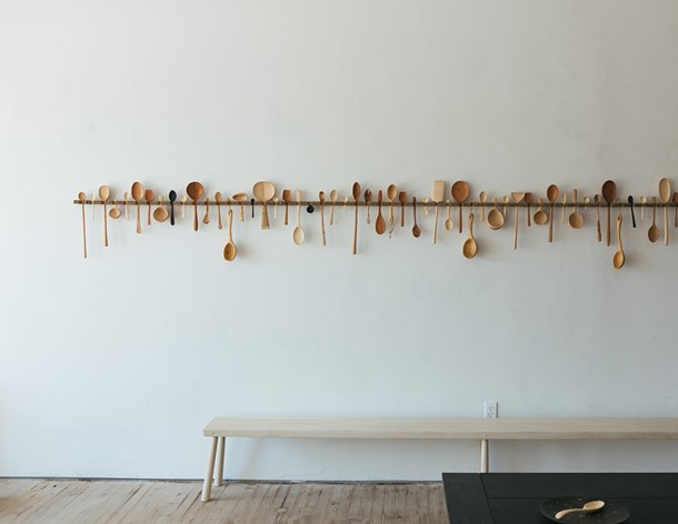 BCMT's wooden spoons hanging in the new showroom.