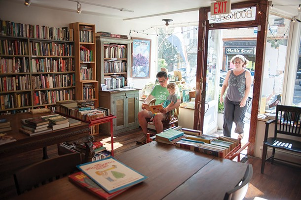Owner Kristi Gibson, and Justin Brehm reading to Fiona at Magpie Bookstore in Catskill. - ROY GUMPEL