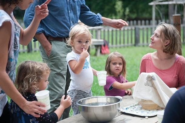 Lead nursery teacher Pema Cliett with students during Primrose Hill School's Polish & Shine family event. - HILLARY HARVEY