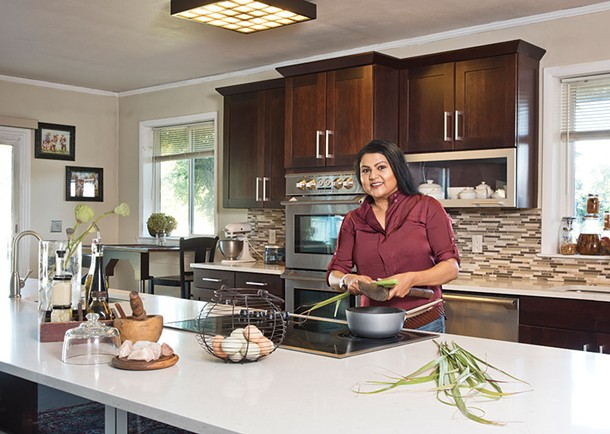 """Nirmala Narine in her farmhouse kitchen. She's been called the """"Indiana Jones of spices."""" Narine likes the nickname, but adds, """"I've done much rougher stuff than him."""" - DEBORAH DEGRAFFENREID"""