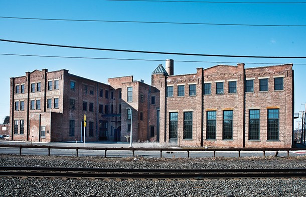 The former US Curtain Factory. Once a thriving manufacturing center, in 2013 the building was converted into 55 units of affordable artist housing; including studios, one-, two-, and three-bedroom units with varying layouts, as well as share-studio and gallery spaces. - DEBORAH DEGRAFFENREID