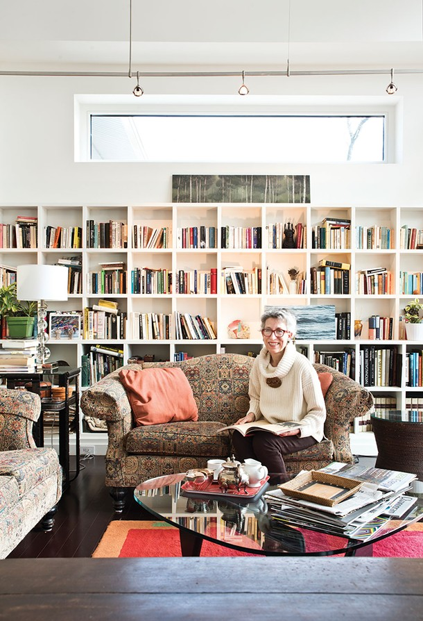"Susan Meyer-Fitzsimmons in her living room. She and her husband Brian Fitzsimmons designed and built their carbon neutral home in Warwick. ""My life is my art, my art is my life; my convictions are my profession and my profession informs how I live—it's all one in the same."" - DEBORAH DEGRAFFENREID"