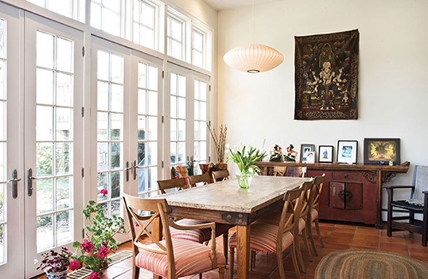 The light-filled dining area offers sumptuous views of the lake and woods surrounding the house. - DEBORAH DEGRAFFENREID
