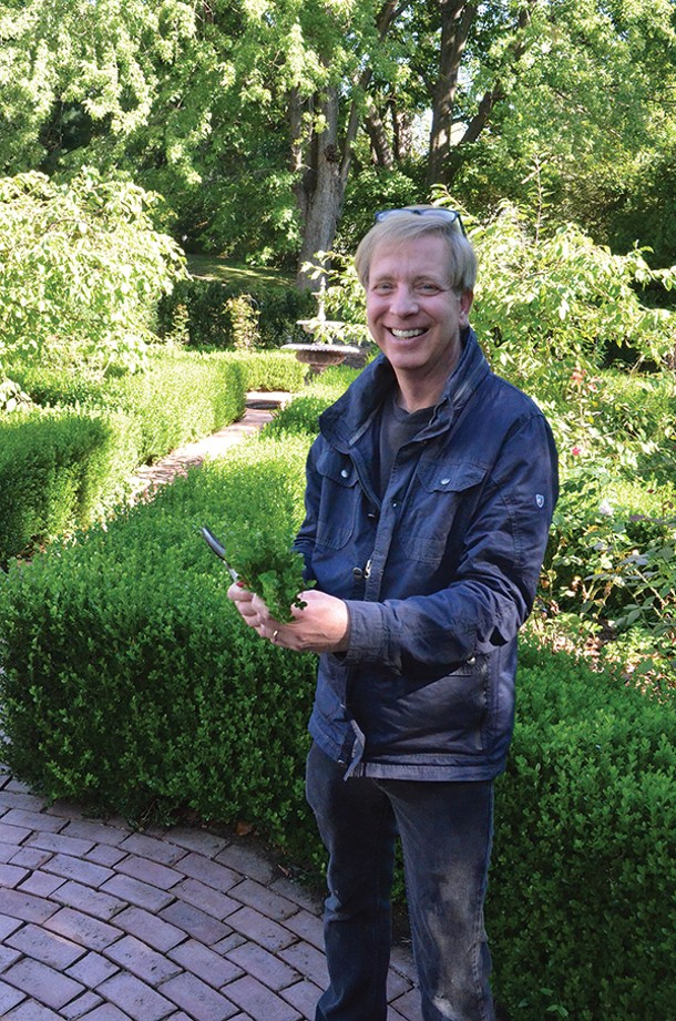 Food and garden blogger Kevin Lee Jacobs in his boxwood garden in Kinderhook. - LARRY DECKER