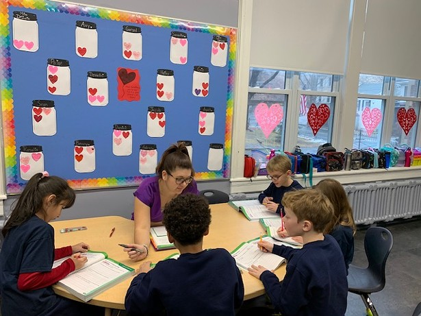 Second-grade students with teacher Dianna DiIulio in a blended learning lesson.