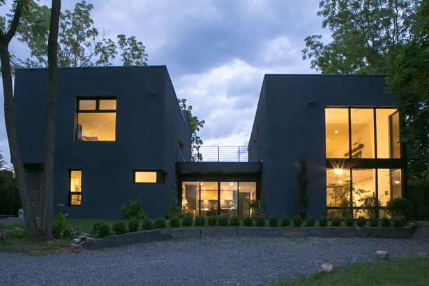 PAINTER & SCULPTOR, Hudson, NY - This studio and residence for two artists is set in a historic neighborhood of Hudson, NY. Designed with the Passive House standard as a guide this project features exterior walls constructed with Insulated Concrete Forms, triple glazed fiberglass windows and a high efficiency gas boiler providing radiant heat - DAN KARP