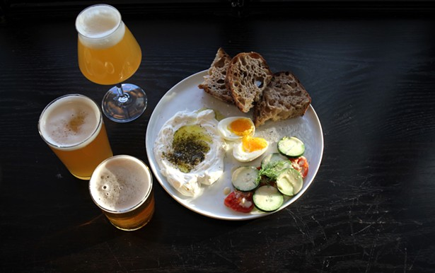 A selection of beers with the Atlantic Avenue breakfast: soft-boiled egg, labneh, roasted tomatoes, cucumbers, and levain toast. - ABBY FOSTER