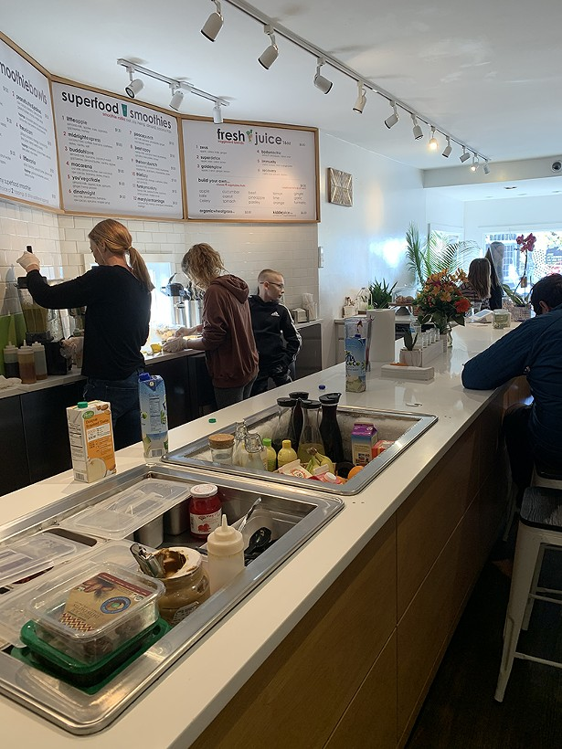 Little Apple staff in action before the pandemic. - LITTLE APPLE CAFÉ