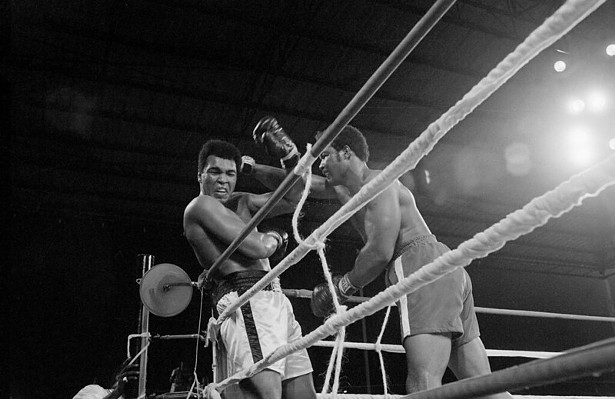 Heavyweight champion George Foreman (r) and Muhammad Ali (l) exchange punches during their world heavyweight title boxing match in 1974. - PUBLIC DOMAIN VIA FLICKR