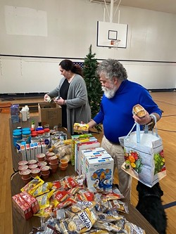 Volunteers unbox groceries at San Miguel Academy's COVID-19 pantry - COURTESY OF SAN MIGUEL ACADEMY