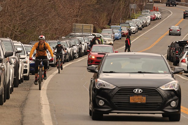 Cars lined up along Route 9D near the trailhead for Breakneck Ridge in early April. What happened to social distancing everybody? - PHOTO BY ROSS CORSAIR