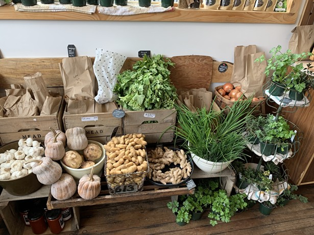 Village Coffee and Goods has expanded their grocery section, including a spread of fresh produce. - VILLAGE COFFEE AND GOODS