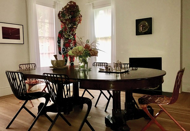 A Nick Cave Soundsuit lurks in the corner of the dining room, which also features a William Eggleston photo, a multimedia work by Matthew Day Jackson, and a fur-lined cup by Pruitt-Early on the table.