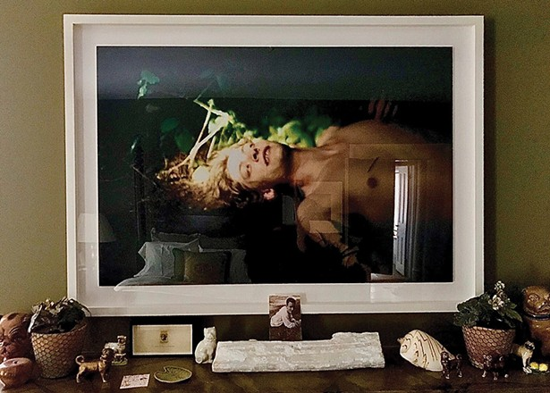 Ryan McGinley's Jake (Golden) adorns the - wall across from the bed in the guest room. In - 2003, at the age of 25, McGinley was one of - the youngest artists to have a solo show at the Whitney Museum of American Art. - MCCRANIE/MAGRI