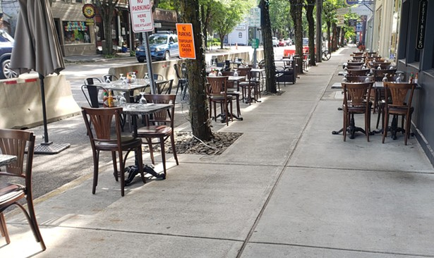 Expanded sidewalk seating outside Le Petit Bistro in Rhinebeck.