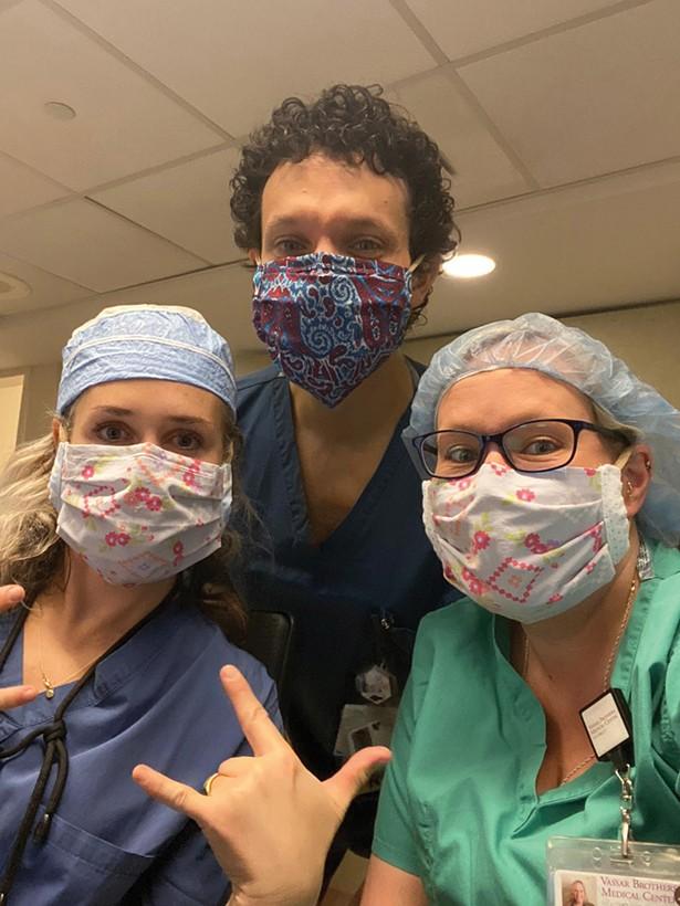Nurses Rebecca Blackwell-Hafner, Daniel Frisina, and Julie Forgit at Vassar Brothers Medical Center, - wearing masks made by Karina - Cousineau and volunteer sewers.