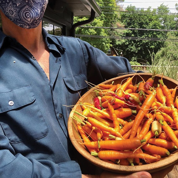 Carrot thinnings from Great Song Farm to be served with Silvia's wood-smoked and brined chicken.