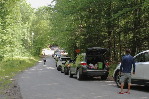 A queue of cars on July 12 waiting for parking spaces to open up at the Laurel House lot, the closest parking area to Kaaterskill Falls. - PHOTO BY ROGER HANNIGAN GILSON