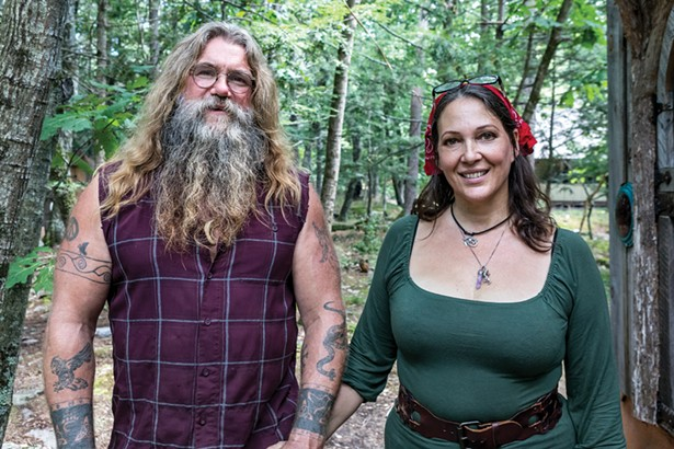 """Hoppy Quick and Julie Snyder at home. They met at a 2017 tiny house convention and soon realized they were kindred spirits. """"We've had parallels running through our whole lives,"""" explains Quick. - PHOTO BY WINONA BARTON-BALLENTINE"""