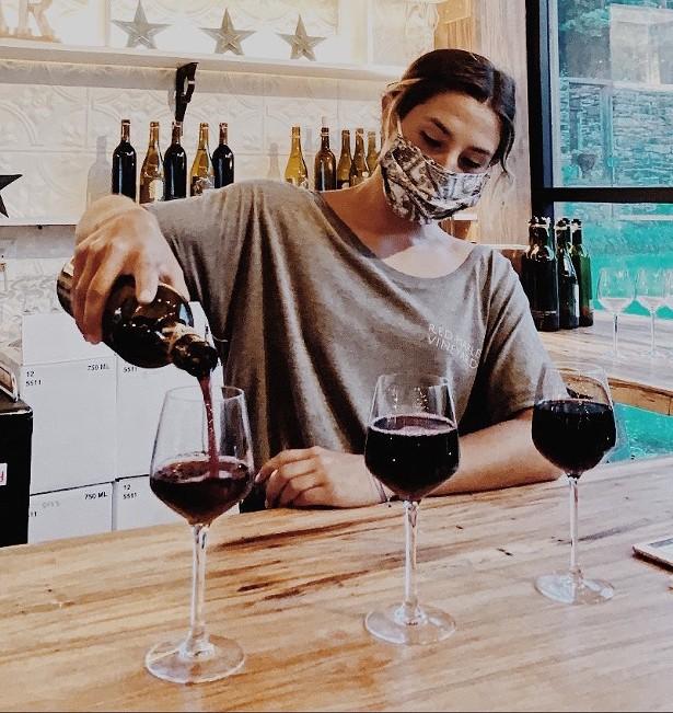 Winemaker Madi Marshall pouring wine