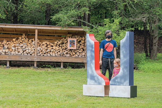 Visitors to Stoneleaf Retreat during Upstate Art Weekend - behind a sculpture by Leah Dixon. - PHOTO BY TRINICIA M PERCH.