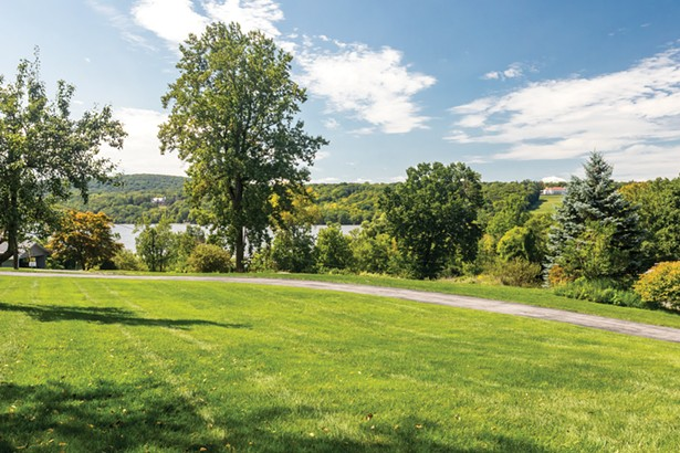 Set on a grassy hill in Hyde Park, Smyle and Schultz's Mid-Century Modern home enjoys sweeping views of the Hudson River. - PHOTO BY WINONA BARTON-BALLENTINE