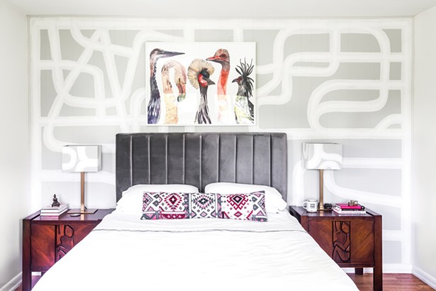"""Top: The home's master bedroom features a custom mural and matching lampshades by Red Hook-based artist Rowan Willigan. The painting of birds above the bed is by Michelle Morin. """"A love of birds is embedded in my culture,"""" says Schultz. """"Parrots and toucans are a part of the ecosystem in Brazil. And now I love the beautiful birds of the Northeast."""" - PHOTO BY WINONA BARTON-BALLENTINE"""