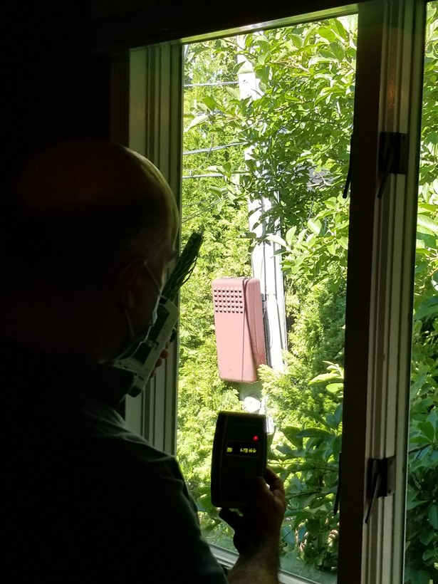 Measuring high radio frequency coming off of a 5G small cell just outside a client's bedroom. - IMAGE COURTESY OF HARRISON BARRITT.