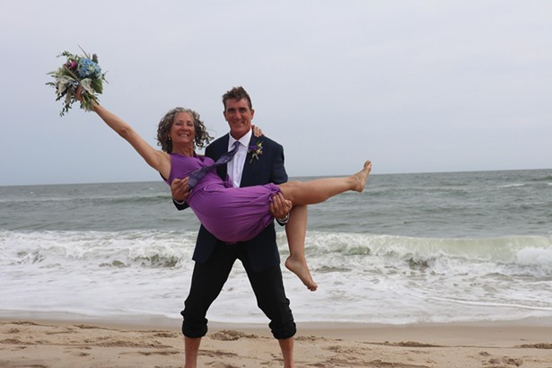 Kevin Misely and Heather O'Leary on the beach in Long Beach Island, New Jersey, where they had an impromptu wedding in late October. - PHOTO BY HOLLY MISLEY