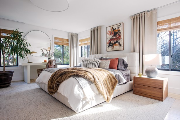 "Like the rest of the house, the master bedroom showcases Oldenburger's design influences. ""I have always been attracted to Midcentury Modern design and Modern architecture,"" she says. ""I am really influenced by contemporary design movements - in California, Australia, and Mexico that focus on minimalist design and incorporate their respective environments."" The 1968 painting above the bed was bought from an antique dealer. ""We are on the hunt for the artist because the signature is nothing we - recognize. It's one of our great mysteries."" - PHOTO BY WINONA BARTON BALLENTINE"
