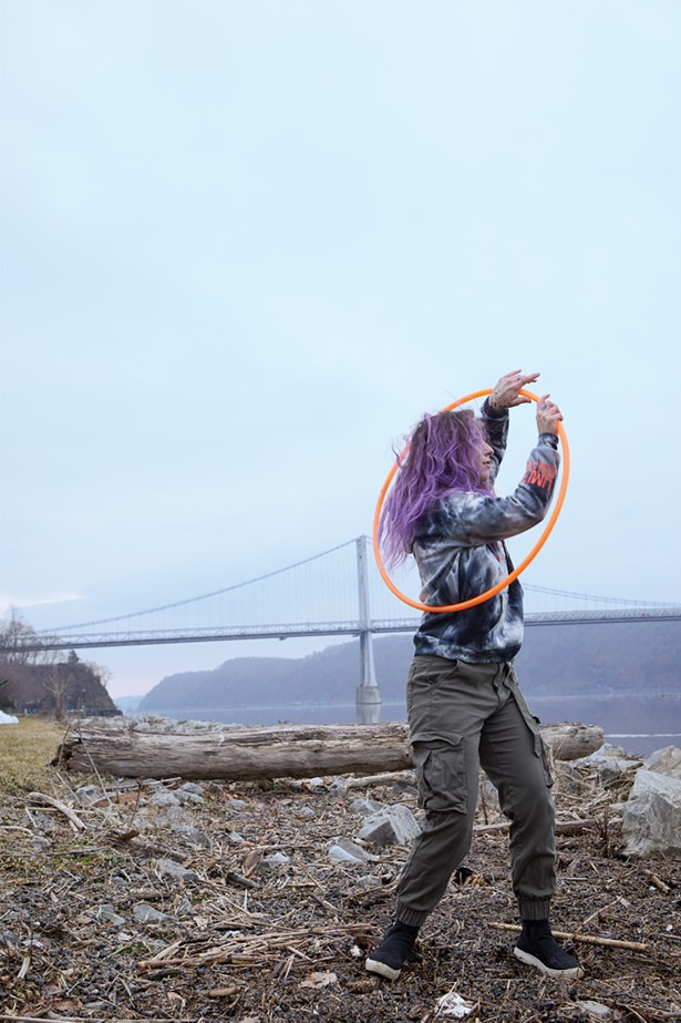 Dominique Manfrede is a hula hoop influencer (@hoopsy_domo) with a large following who practices daily at Upper Landing Park. - PHOTO BY DAVID MCINTYRE