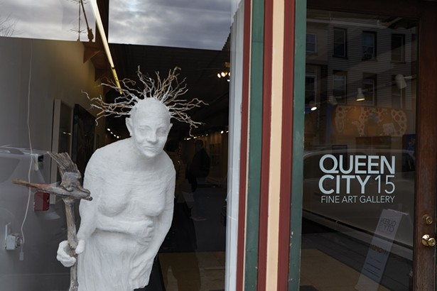 Queen City 15 is a member-run art gallery on Main Street. The sculpture in the window is Gnome Lisa by Lisa Winika. - PHOTO BY DAVID MCINTYRE
