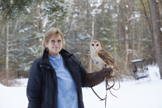 Ellen Kalish of Ravensbeard Wildlife Center with Twyla, a rescued barn owl. Ravensbeard was in the national news after Rocky, a saw-whet owl who was rescued from the Rockefeller Center Christmas tree, was rehabilitated there. - DAVID MCINTYRE