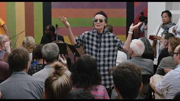 Artist Laurie Anderson speaks to a group at MASS MoCA in 2016. - FILM STILLS COURTESY OF THE OFFICE ARTS