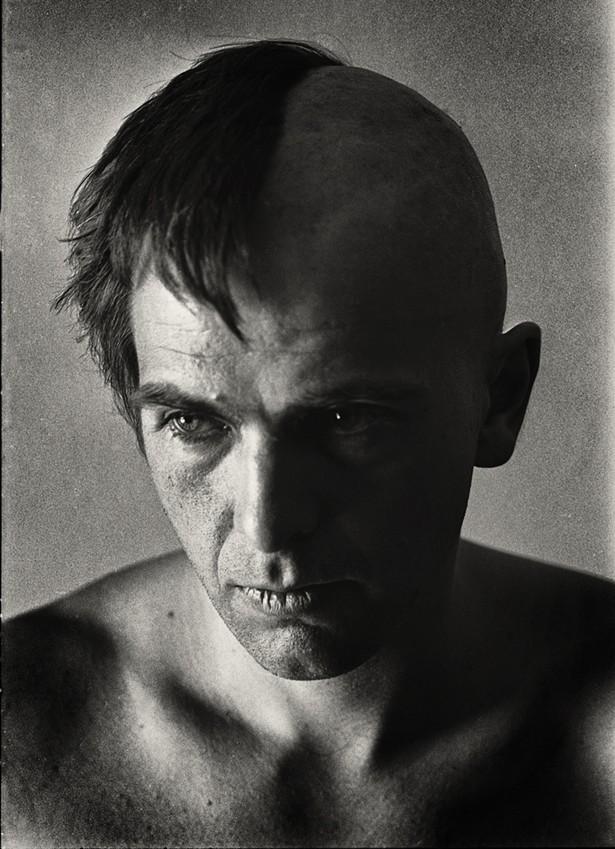 Peter Gabriel halfway through shaving his head.